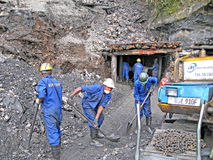 Rwandan Precious Metal Miners. The men are mining precious metals - tungsten and tantalum - that are widely used in the electronics industries and which are also Stock Photography