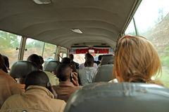 Rwandan Bus Passengers. Rwandans travelling on a public bus talking on cell phones. Pictures also shows difference in hair growth between Africans and a royalty free stock photo