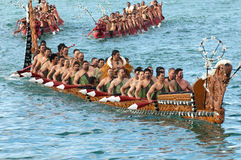 RWC Maori Waka's. Opening of the Rugby World Cup 2011, Maori Waka (war canoes) enter downtown Auckland's Viaduct Harbour stock image