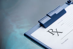 RX medical prescription form. RX prescription form on stainless steel desk blue tone Royalty Free Stock Images