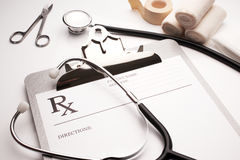 Rx prescription concept stethoscope and bandages. On white table royalty free stock photos