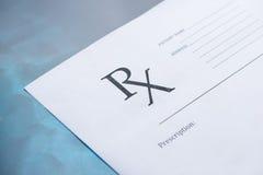 RX prescription form. On blue background Royalty Free Stock Photos
