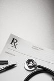RX prescription form stethoscope and pen. On stainless steel background royalty free stock images
