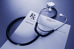 RX prescription form and stethoscope on stainless Royalty Free Stock Photo