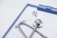 RX prescription form and stethoscope on stainless Royalty Free Stock Image