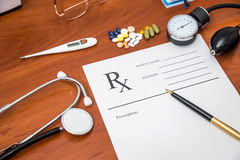 Rx prescription with pills, stethoscope, thermometer. And pen Stock Images