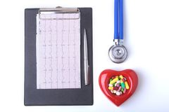 RX prescription, Red heart, asorted pils and a stethoscope on white background.  Stock Images