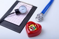 RX prescription, Red heart, asorted pils and a stethoscope on white background.  Royalty Free Stock Photography