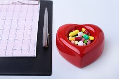 RX prescription, Red heart, asorted pils and a stethoscope on white background.  Royalty Free Stock Photo