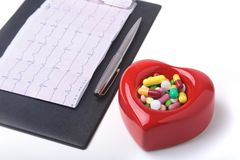 RX prescription, Red heart, asorted pils and a stethoscope on white background.  Stock Photography