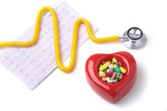 RX prescription, Red heart, asorted pils and a stethoscope on white background.  Stock Image