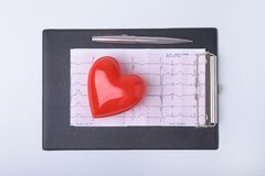 RX prescription, Red heart, asorted pils and a stethoscope on white background.  Stock Photo