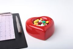 RX prescription, Red heart, asorted pils and a stethoscope on white background.  Royalty Free Stock Image
