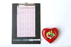 RX prescription, Red heart, asorted pils and a stethoscope on white background.  Stock Photos
