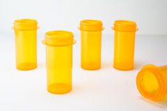 5 Rx Vials staggered on white, representing healthcare & insurance costs, wellness or addiction Royalty Free Stock Photo
