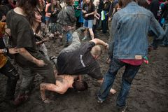 Madness in the mud at the RyÅ›ka festival in Chorzów. Poland. At the Ryśka Festival, fans of the dead vocalist band Dżem. The name of the Ryśka Festival royalty free stock photos