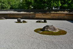 The dry garden, detail. Ryoan-ji zen temple. Kyoto. Japan. Ryōan-ji is a Zen temple located in northwest Kyoto; the Ryōan-ji garden is considered one of the Royalty Free Stock Photo