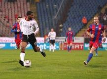 Ryan Babel and Iasmin Latovlevici. Steaua Bucharest vs. Liverpool match Royalty Free Stock Photo