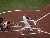 Ryan Howard connects with incoming pitch Stock Image
