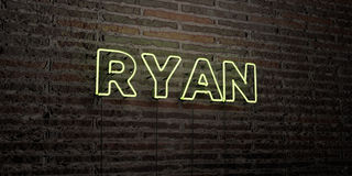 RYAN -Realistic Neon Sign on Brick Wall background - 3D rendered royalty free stock image Stock Image