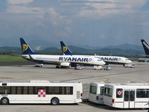 Ryanair aircrafts and passenger shuttles Stock Photo