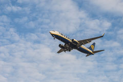 Ryanair airliner jet approach to land with landing gear displayed, seen from below Stock Photos