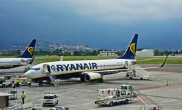 Ryanair 737-800. An airplane 737-800 of the Ryanair flight company getting land assistance at the airport of Bergamo - Milan Stock Image