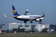 Ryanair Boeing jet landing on Amsterdam Airport Schiphol AMS. Netherlands. ATC Air traffic control tower stock images