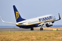 Ryanair lines low cost takes elevation final piste running in airport Royalty Free Stock Photos