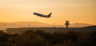 Ryanair plane departing in sunset. Photograph of a plane departing from El Prat airport, Barcelona, Spain Stock Photos