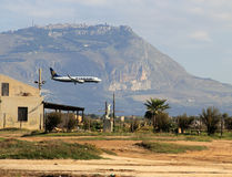 Ryanair plane in landing. Landing of a Ryanair plane at the airport of Trapani/Birgi in Sicily - New transfer service across Europe Royalty Free Stock Image