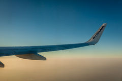 Ryanair wing at sunset Royalty Free Stock Photography