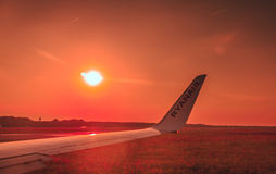 Ryanair wing at sunset royalty free stock images