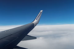 Ryanair wing tip on aircraft over clouds. Royalty Free Stock Photography