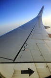 Ryanair passenger jet wing winglet. Ryanair wing and winglet against deep blue sky. Upright image Stock Photography