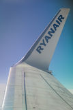 Ryanair winglet close up. Ryanair plane winglet above the clouds Royalty Free Stock Image