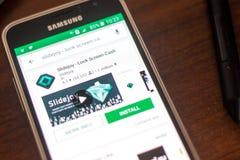 Ryazan, Ρωσία - 4 Μαΐου 2018: Εικονίδιο Slidejoy στον κατάλογο κινητών apps στην επίδειξη του τηλεφώνου κυττάρων Στοκ Εικόνες