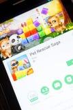 Ryazan, Rússia - 24 de junho de 2018: Pet a saga app móvel do salvamento na exposição do PC da tabuleta imagem de stock