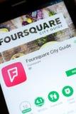 Ryazan, Rusland - Juni 24, 2018: Foursquare Stadsgids mobiele app op de vertoning van tabletpc stock foto's