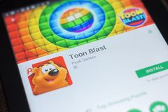 Ryazan, Russia - April 19, 2018 - Toon Blast mobile app on the display of tablet PC. Ryazan, Russia - April 19, 2018 - Toon Blast mobile app on the display of Stock Photo