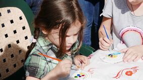 Ryazan, Russia - July 25: Little girl membering in paint contest on street festival.