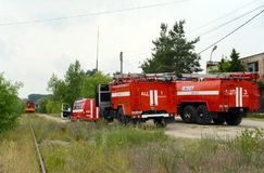 Deployment of fire trucks at the railway. RYAZAN, RUSSIA - JUNE 16, 2015: Deployment of fire trucks at the railway Stock Image