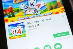 Ryazan, Russia - June 24, 2018: Solitaire - Grand Harvest mobile app on the display of tablet PC. royalty free stock images