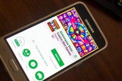 Ryazan, Russia - May 04, 2018: Slotomania Slots mobile app on the display of cell phone. Ryazan, Russia - May 04, 2018: Slotomania Slots mobile app on the Stock Image