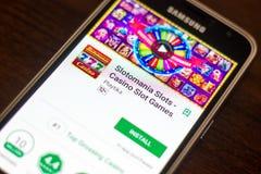 Ryazan, Russia - May 04, 2018: Slotomania Slots mobile app on the display of cell phone. Ryazan, Russia - May 04, 2018: Slotomania Slots mobile app on the Stock Photography
