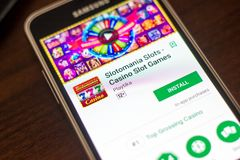 Ryazan, Russia - May 04, 2018: Slotomania Slots mobile app on the display of cell phone. Ryazan, Russia - May 04, 2018: Slotomania Slots mobile app on the Stock Photo