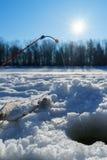 Ryba i prącie na lodzie blisko do dziury podczas gdy zima połów Obraz Royalty Free