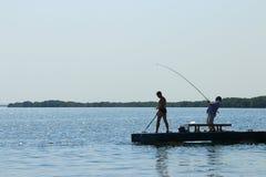 Rybacy na molu Obrazy Royalty Free