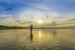 Rybak i wschód słońca Zdjęcie Royalty Free