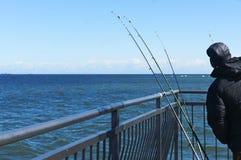 Rybak, morze, połów, połowów prącia, chwyt, molo, połów fotografia royalty free